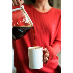 woman pouring coffee made with great-tasting Culligan Water